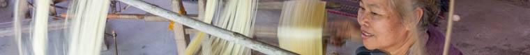 woman spinning silk