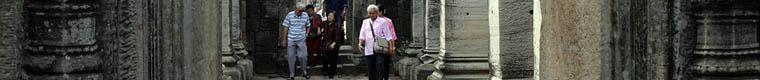 people walking through Phimai Khmer temple ruin