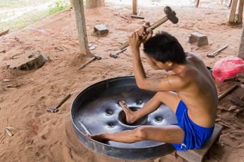 man making a gong