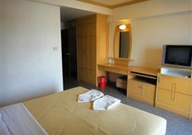 simple hotel room with tv
