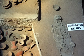 skeleton and pottery in a burial site