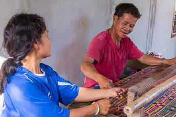 couple weaving sitting mat