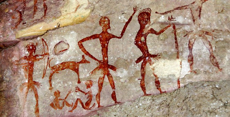ancient rick paintings of people and a dog