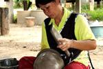 woman making a pot with a paddle