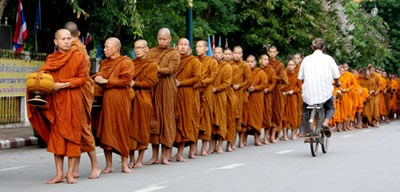 row of monks collecting alms