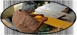 woman weaving mut-mee silk