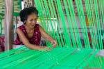 woman setting up a loom
