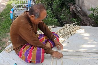man weaving bamboo