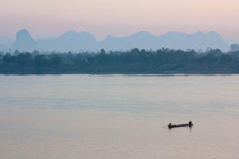 boat on mekong river at sunrise