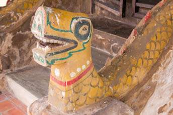 old naga along stairs in front of an ubosot