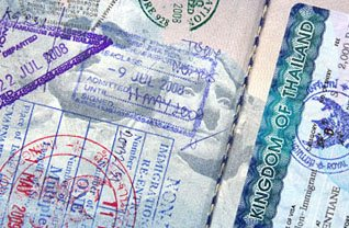 passport page with many stamps
