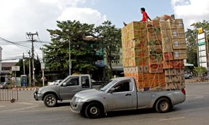 pickup truck carrying dozens of boxes