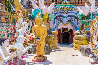 Buddha and many other statues at a temple