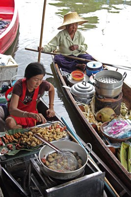 two women selling food from boats