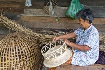 woman weaving rattan