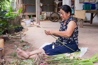 woman cutting galangal