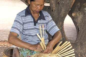 woman weaving bamboo